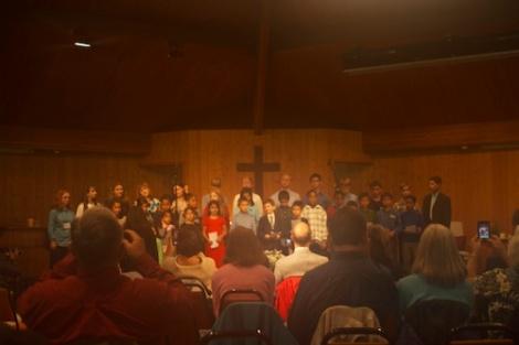 "The children's choir singing ""Pass It On"" on Sabbath"